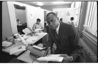 African American lawyer Vernon E. Jordan working on a voter education project, seated at a desk with a typewriter at the Southern Regional Council, Atlanta, Georgia