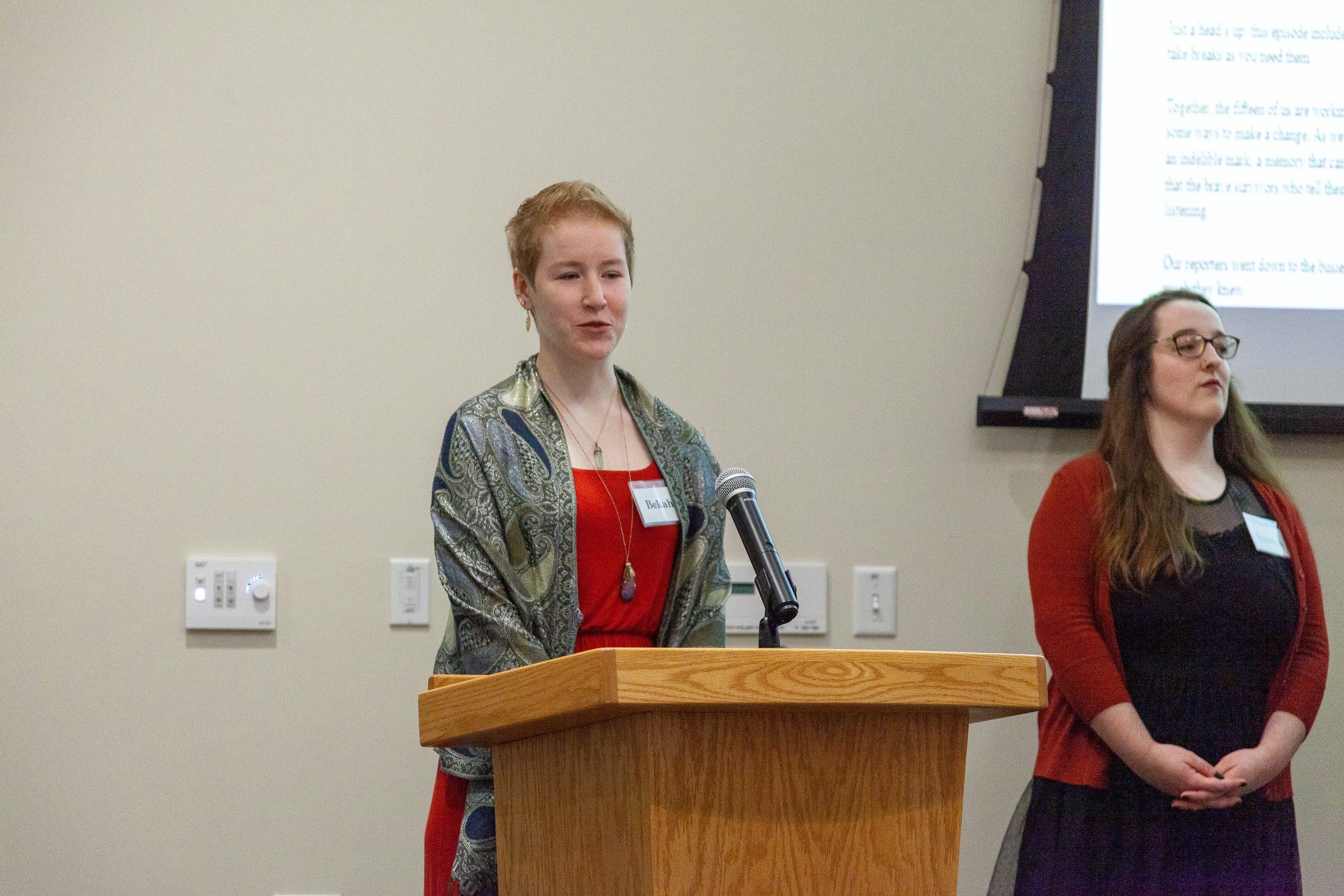 Bekah at the podium.